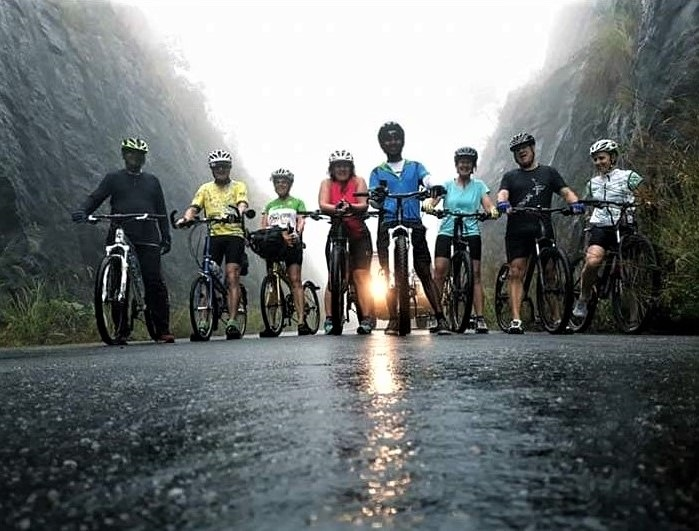 Group of cyclists posing on a road