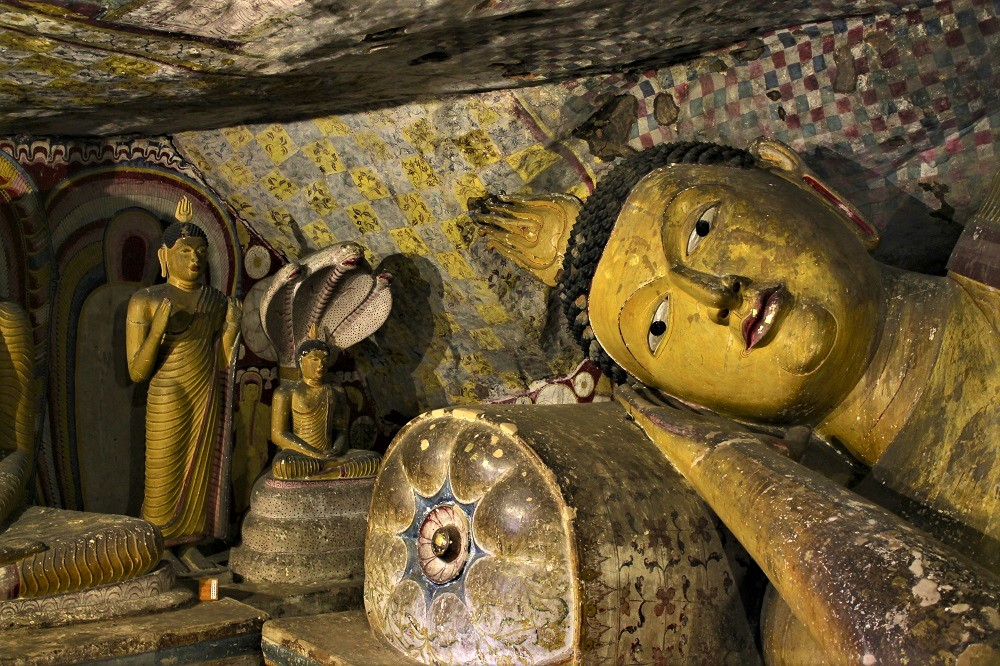Several gold-colored Buddha in a cellar