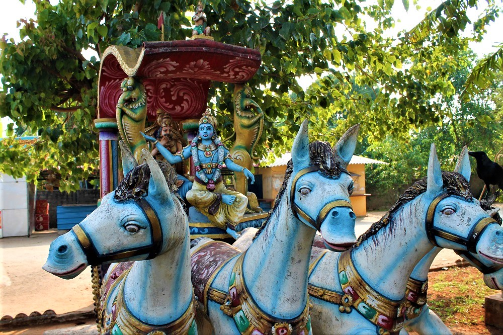 Hindu statue with 4 horses and a carriage with Monkey God