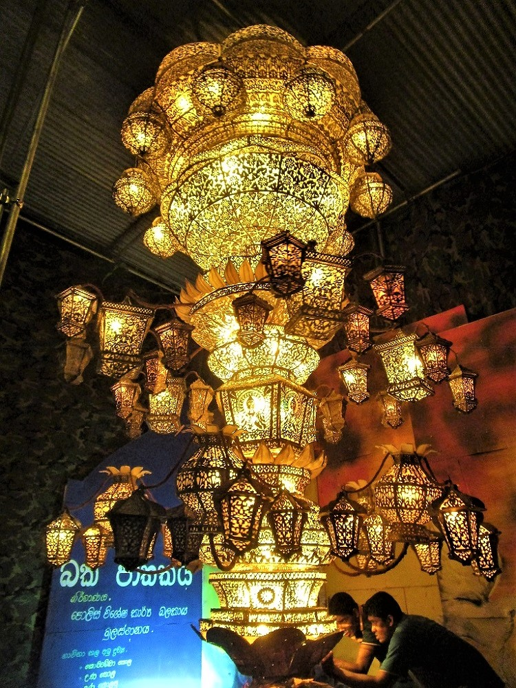 Large traditional and religious lantern with two men